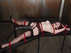 Emily Marilyn tied in a dirty black hole
