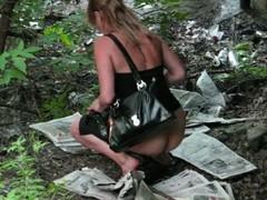 Elegant chick pissing in voyeur video