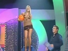 A silly yet sexy tow-haired call-girl poorly dances on a obey television mandate