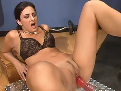 Ava Ramon gets satisfied by a fucking machine in a gym