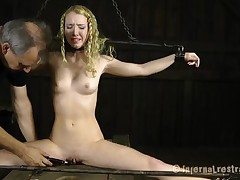 Gagged with an increment of fastened up beauty gets her clits gratified