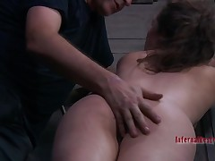 Beauty gets her cunt satisfied whilst inside a cage